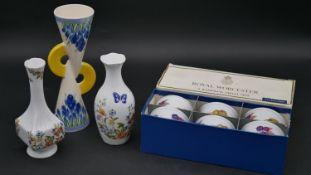 A boxed set of Royal Worcester Evesham porcelain ramekins, two Aynsley Cottage Garden design vases