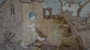 A Georgian gilt framed and glazed silk and watercolour embroidery of an old woman sitting in front