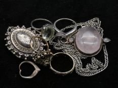 A collection of silver jewellery. To include a silver Victorian locket, a Rose quartz pendant with