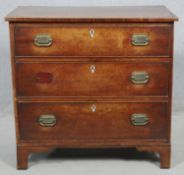 A compact Georgian mahogany chest of three long drawers on bracket feet. H.75.5 W.79 D.45.5cm (one