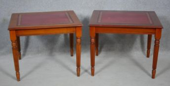 A pair of late Georgian style mahogany lamp tables with inset leather tops on reeded tapering