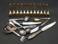 A collection of as new various patterns of Christofle, Paris cutlery. Includes twelve gilded