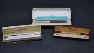 A collection of writing implements. Including a boxed Parker 51 maroon dip and fill pen with