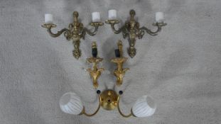 A pair of metal twin branch wall sconces, a pair of gilt metal Rococo sconces and a vintage twin