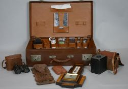 A collection of items. To include a Lufft Art Deco veneered Barometer, a leather suitcase with