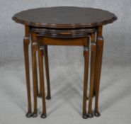 A mid century burr walnut nest of tables in the Queen Anne style. H.58 L.59 W.41cm