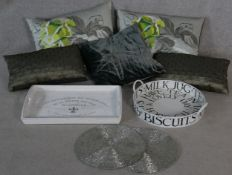A collection of contemporary trays, beaded place mats and five silk and velvet designer cushions,