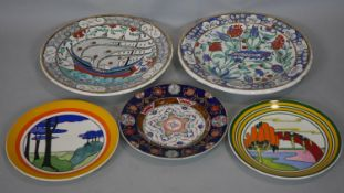 A collection of ceramics. Including Two Wedgwood limited edition Clarice Cliff plates, one 'Blue