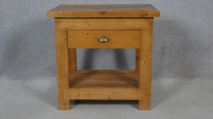 A vintage pine butcher's block style kitchen table fitted with frieze drawer on square supports