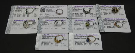 Ten gemstone set rings with certificates. To include a 9ct yellow gold Ethiopian opal and emerald