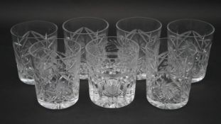 A collection of seven cut crystal whisky tumblers. Including an Atlantis crystal tumbler with