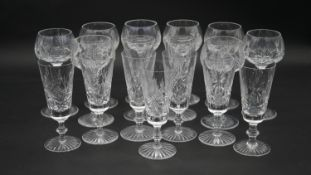 A collection of cut Edinburgh crystal glasses. Including a set of eight foliate design wine