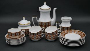 A vintage Soviet era coffee service, viz: coffee pot, milk jug, sugar bowl, cups, saucers and