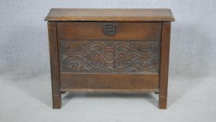 A Jacobean style small coffer with carved panels on reeded block supports. H.58 W.75 D.26cm (a piece