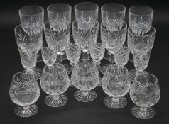 A collection of twenty one cut crystal glasses. Including ten foliate design wine glasses, five
