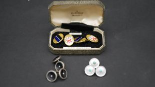 A collection of cufflinks and shirt buttons. Including a boxed set of gold cased enamel Dulwich