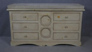 A Continental painted chest of six drawers with limestone slab top on shaped bracket feet. H.90 W.
