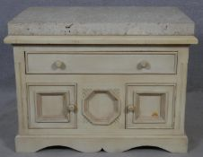 A Continental painted side cabinet with limestone slab top on shaped bracket feet. H.67 W.91 D.61cm