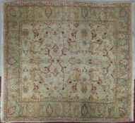 A Persian Ziegler Mahal style carpet with scrolling foliate and animal motifs across the fawn