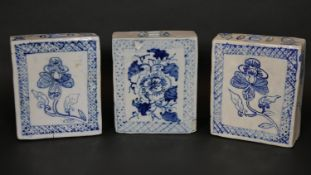 Three Chinese blue and white hand painted porcelain flower bricks with geometric border and stylised