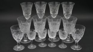 A collection of fourteen cut crystal glasses. Including a set of four engraved and cut crystal
