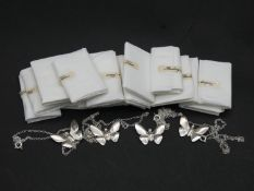 Twenty as new sterling silver butterfly pendants on chains. Stamped Lesley, Silver. Each with secure