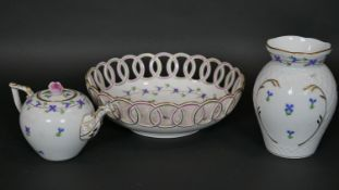 Three items of matching Herend porcelain, a pierced bowl, teapot and vase each hand decorated in