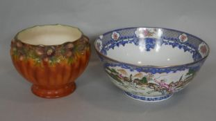 A large Chinese export Famille Rose hand painted porcelain punch bowl decorated with hunting
