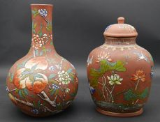 Two Chinese Yixing stoneware pieces, 20th Century, each enamelled with different designs. The urn