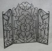A vintage wrought iron and mesh triple section fire screen. H.104 W.120cm