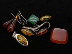A collection of amber and silver jewellery with various gemstones. To include a matching silver