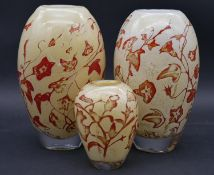 Olle Brozen for Kosta Boda, a pair of floral decorated glass vases and a similar smaller vase,