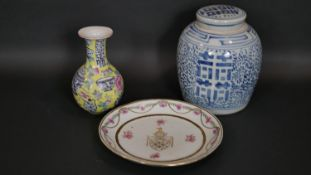 A Chinese Famille Rose armorial plate along with an Imperial yellow hand painted porcelain bottle