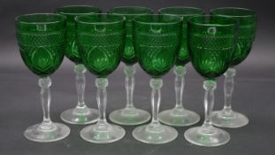 A set of eight vintage emerald moulded glass wine goblets on clear glass stems. H.20.5cm