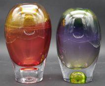 Goran Warff for Kosta Boda, a coloured Art Glass vase along with a similar vase, each signed G Warrf