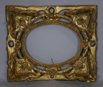 A 19th century giltwood frame with carved shell, swag, ribbon and foliate decoration. H.32 W.38cm