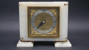 A vintage Elliot white alabaster and gilt mantle clock, retailed by Garrard & Co, Ltd, Regent