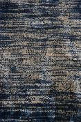 A hand tufted bamboo silk rug with abstract stylised design on an enamel blue ground. L.230 W.160