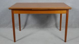 A mid century vintage teak draw leaf dining table by Erik Buch stamped Made in Denmark to the