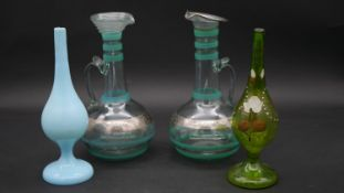 A collection of blown antique glass. Including a pale blue opaline glass bottle with an enamel