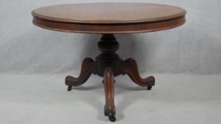A Victorian mahogany tilt top dining table on carved pedestal tripod cabriole base. H.77 D.117.5cm