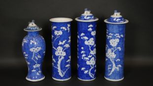 Four Chinese blue and white porcelain vases, three of cylindrical form with prunus blossom