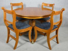 A Regency style yew wood dining table and matching bar back dining chairs. Table H.77 W.107cm Chairs