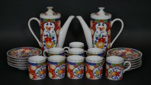 A Japanese transfer printed coffee service in the Imari palette comprising two coffee pots, nine