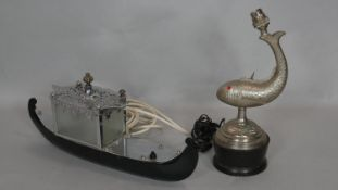 An embossed metal table lamp in the form of a leaping fish and a vintage gondola table lamp. H.