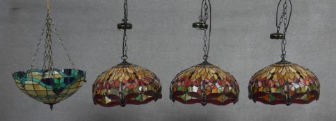 A set of three Tiffany style ceiling light pendant shades in coloured leaded glass with dragonfly