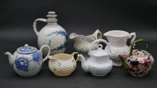 A miscellaneous collection of 19th century and later ceramics and porcelain to include teapots, milk