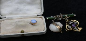 A collection of antique jewellery. Including a yellow metal and seed pearl shell brooch, a jade,