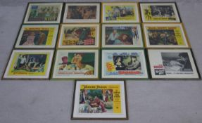 A collection of thirteen framed and glazed movie posters from the golden age of Hollywood. H.35 W.
