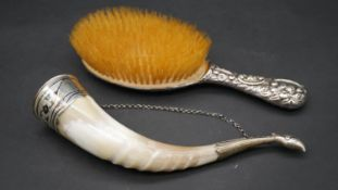 An antique silver repousse work hair brush with a goose, a cottage and a dog along with a Russian